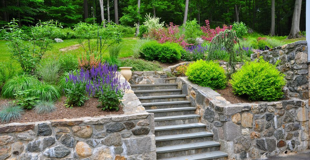 Multi-level Sloped Rock And Grass Garden