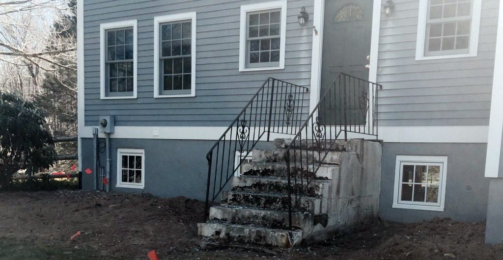 Before – Stone Staircase Entrance With Wrought Iron Railing