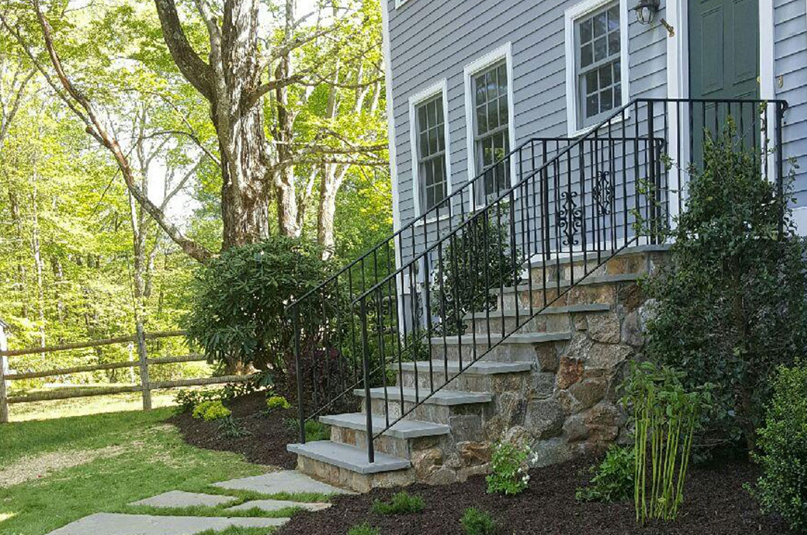 Stone Staircase Entrance With Wrought Iron Railing