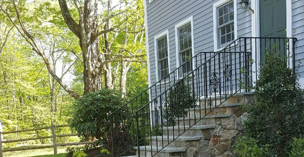 Completed – Stone Staircase Entrance With Wrought Iron Railing