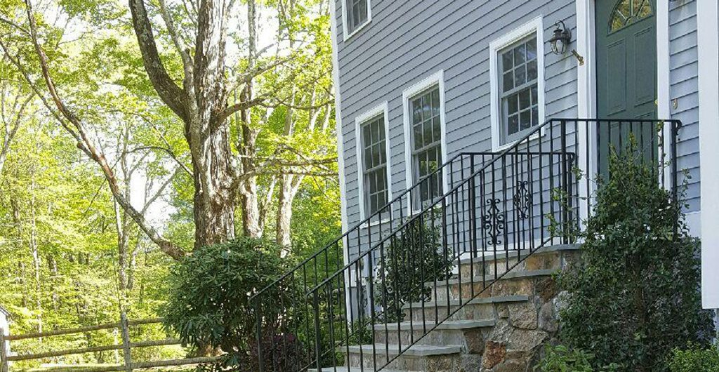 Finished Project – Stone Staircase Entrance With Wrought Iron Railing