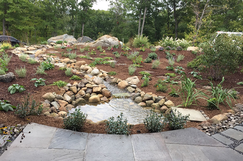 Fossum Property Water Feature with River Rock Pathways Landscape Design Featured Image