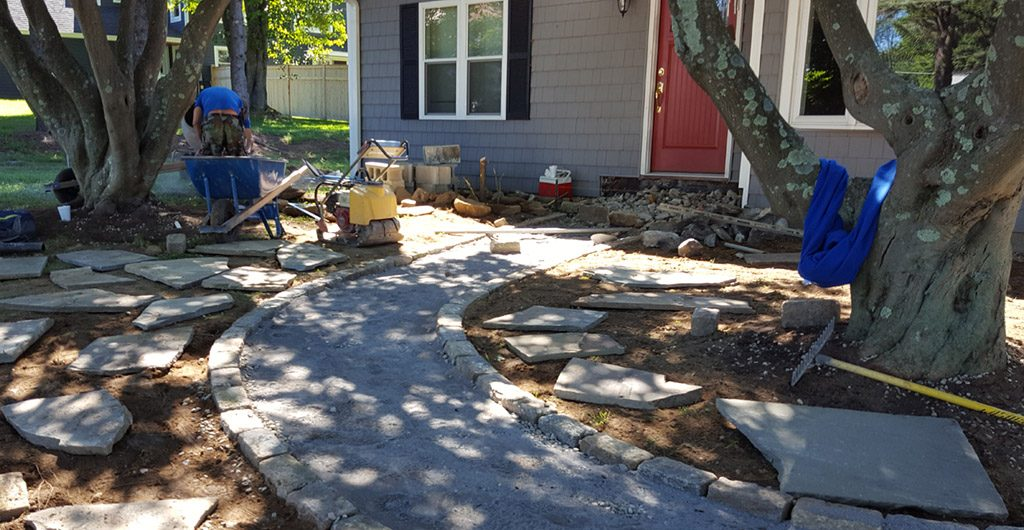 During Construction – Entrance Stone Walkway, Landscaping, Patio Deck & Storage Shed 11