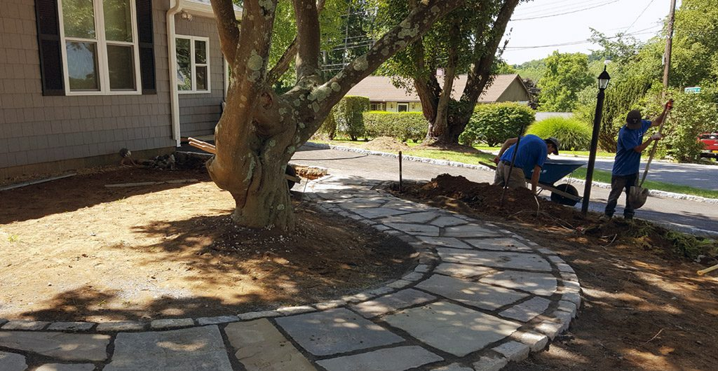 During Construction – Entrance Stone Walkway, Landscaping, Patio Deck & Storage Shed 12