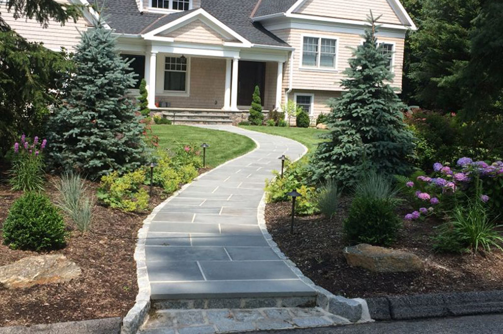 Residential Landscaping And Curved Entry Pathway